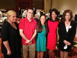 Liz Brunner (center right) with MBTA police officer Dic Donohue who was wounded during the Watertown shootout at a American Red Cross blood drive in July 2013.