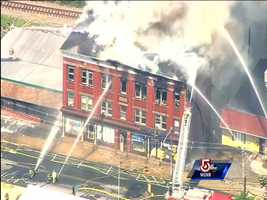 Fire ripped through a three-story building on South Main St. in Uxbridge Thursday afternoon.