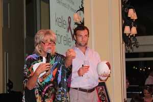 Susan, seen here with Wes Welker, also emcees the annual Kelley For Ellie Fundraiser. The Ellie Fund fights breast cancer by helping women with the disease and their families.