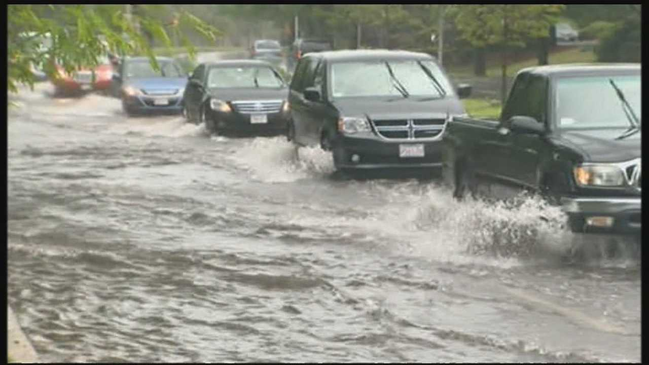 Downpours flood roads
