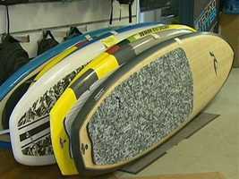 Owner Mark Keup says stand up paddle boards don't require waves, and they've changed the whole game.