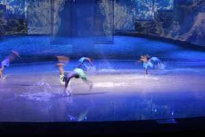 Acrobats and dancers join the finale by doing flips in the water
