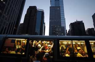 People try to board the back of a crowded Manhattan bus during the power outage in New York Thursday, Aug. 14, 2003. Buses were packed to capacity after the subway lines closed down during the outage.