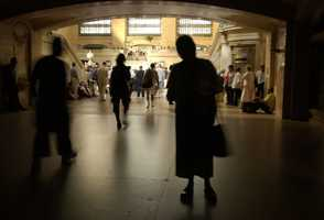 Commuters and travelers flow out of the darkened hallways toward the main waiting area inside Grand Central Station in New York City, after a massive power outage Thursday, Aug. 14, 2003, that hit U.S. and Canadian cities. The outage disrupted cell phone service in New York, the subway system, and trains going in and out.