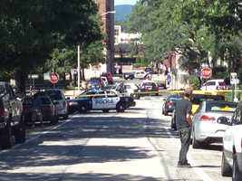 Multiple officers were crouched behind their cruisers outside the building and several downtown streets were blocked off. The YWCA was surrounded by police with guns drawn and wearing bulletproof vests.