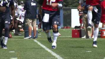 The Patriots quarterback was wearing a brace on his left knee.