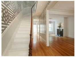 This Greek revival townhouse is on a prestigious street.
