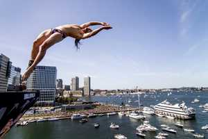 Orlando Duque of Colombia dives from the 90 foot platform during the fifth stop of the Red Bull Cliff Diving World Series, Boston, USA on August 25th 2013.