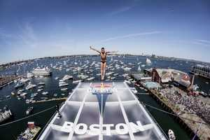 Artem Silchenko of Russia dives from the 90 foot platform during the fifth stop of the Red Bull Cliff Diving World Series, Boston, USA on August 25th 2013.