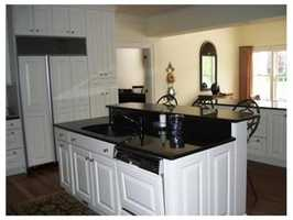 The kitchen opens into a dining area.