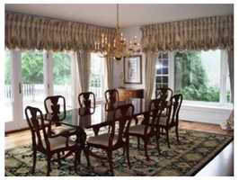 The elegant dining area overlooks the grounds.