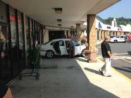 A police officer was injured when a car crashed into a Worcester store.