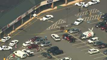 The car slammed into a Payless store.