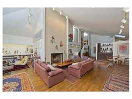 This true contemporary gem is located in the prestigious and sought after Country Club area of Brookline.