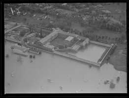 An aerial view of a flooded prison.