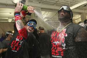 Boston Red Sox designated hitter David Ortiz, right, and teammate Mike Carp celebrate after the Red Sox clinched the AL East with a 6-3 win over the Toronto Blue Jays in a baseball game at Fenway Park, Friday, Sept. 20, 2013, in Boston.
