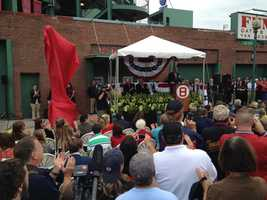 The statue of Carl Yastrzemski about to be unveiled outside Fenway Park on Sunday, Sept. 22, 2013.