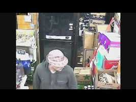 The man, who was wearing a pink fedora, walked into Super Liquors at 36 South Broadway at 9 p.m.