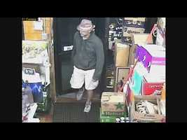 Lawrence police are searching for a man who robbed a liquor store Thursday.