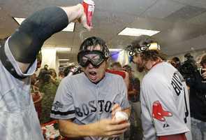 Boston Red Sox pitcher Koji Uehara celebrates.