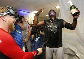 Boston Red Sox 's David Ortiz, right, is sprayed with champagne.