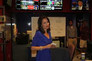 Liz tells the WCVB-TV staff of her plans