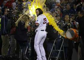 Boston Red Sox's Jarrod Saltalamacchia is  sprayed with sports drink during an interview after Game 2 of the American League baseball championship series against the Detroit Tigers Sunday, Oct. 13, 2013, in Boston. The Red Sox won 6-5.