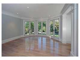 French doors lead to a professionally landscaped yard.