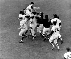 """Impossible Dream Team""Boston Red Sox pitcher Jim Lonborg is lifted by his teammates following their 5 to 3 victory over the Minnesota Twins at Fenway Park, Oct. 2, 1967. The victory gave the American League pennant to what was dubbed as the ""Impossible Dream"" team."