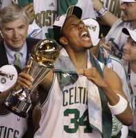 """NBA Championship drought ends""Celtics forward Paul Pierce shouts as he holds the MVP trophy as the Boston Celtics celebrate their 131-92 win over the Los Angeles Lakers to win the NBA basketball Championship in Boston, June 17, 2008.  It was the first Celtics NBA Championship since 1986."