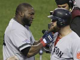 Boston Red Sox's David Ortiz pulls on the beard of Mike Napoli after Napoli hits a home run in the seventh inning during Game 3 of the American League baseball championship series against the Detroit Tigers, Oct. 15, 2013, in Detroit.