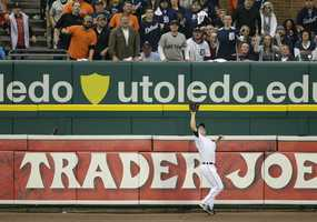 Detroit Tigers left fielder Andy Dirks catches a fly ball hit by Boston Red Sox's David Ortiz in the fourth inning during Game 3 of the American League baseball championship series Tuesday, Oct. 15, 2013, in Detroit.