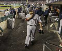 Boston Red Sox starting pitcher John Lackey walks in the dugout after being taken out in the seventh inning during Game 3 of the American League baseball championship series against the Detroit Tigers Tuesday, Oct. 15, 2013, in Detroit.