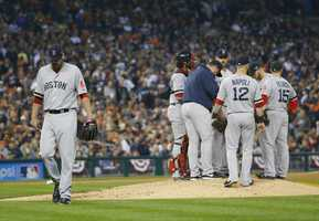 Boston Red Sox's John Lackey is taken out of the game in the seventh inning during Game 3 of the American League baseball championship series against the Detroit Tigers Tuesday, Oct. 15, 2013, in Detroit.