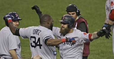 Boston Red Sox's David Ortiz celebrates with Mike Napoli after Napoli hits a home run in the seventh inning during Game 3 of the American League baseball championship series against the Detroit Tigers Tuesday, Oct. 15, 2013, in Detroit.