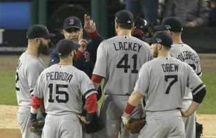 Boston Red Sox manager John Farrell calls for Craig Breslow to take over for John Lackey (41) in the seventh inning during Game 3 of the American League baseball championship series against the Detroit Tigers Tuesday, Oct. 15, 2013, in Detroit.