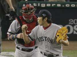 Boston Red Sox's Koji Uehara celebrates after the Red Sox defeated the Detroit Tigers 1-0 in Game 3 of the American League baseball championship series Tuesday, Oct. 15, 2013, in Detroit.