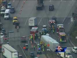 A tractor-trailer flipped over on the ramp from Interstate 495 to the Massachusetts Turnpike Thursday.