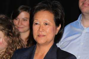 NewsCenter 5's Janet Wu looks on.