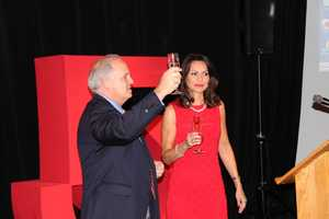WCVB-TV President and General Manager Bill Fine leads a champagne toast.