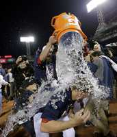 Boston Red Sox's Jonny Gomes dunks Jake Peavy after the Red Sox beat the Detroit Tigers 5-2 in Game 6 of the American League baseball championship series.