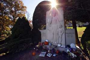 "The grave of George Herman 'Babe'' Ruth is decorated with items left by New York Yankees and Boston Red Sox fans, Thursday, Oct. 28, 2004 in Hawthorne. The ""Curse of the Bambino"" has followed Boston through four World Series defeats, each one in seven games. The end of the drought came Wednesday, Oct. 27, when Boston completed a sweep of the St. Louis Cardinals to win the World Series."