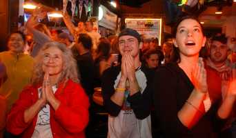 Red Sox fans at Rafter's Bar in Amherst, Mass. react to Sox victory in the World Series on Wednesday, October 27, 2004.