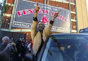 A jubilant Pedro Martinez, of the Boston Red Sox, acknowledges the crowd that gathered around Fenway Park in Boston early Thursday morning Oct. 28, 2004. Martinez and the Boston Red Sox swept the St Louis Cardinals in four games to win their first World Series since 1918.