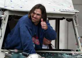 Boston Red Sox's Jonny Damon reacts to the crowd during the Boston Red Sox's victory parade, Saturday Oct, 30, 2004 in Boston. Hundreds of thousands of Red Sox fans jammed streets and the banks of the Charles River on Saturday to watch a parade many had begun to doubt they would ever witness: a toast to a World Series champion team.