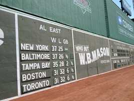The left field scoreboard features the initials of Tom and Jean Yawkey in Morse Code.