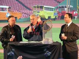 Mayor Thomas Menino with Red Sox broadcasters Jerry Remy and Don Orsillo at Fenway Park with the World Series trophy.