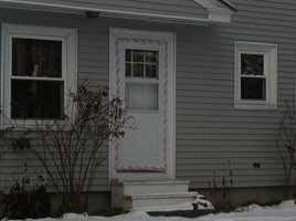 "January 1, 2012: Crime scene tape taken off 29 Violette Ave. ""No Trespassing"" sign goes up"