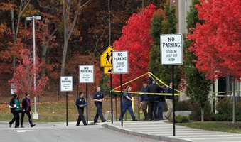Crime scene investigators enter Danvers High School investigating the murder of teacher Colleen Ritzer whose body was found behind the school Wednesday morning Oct. 23
