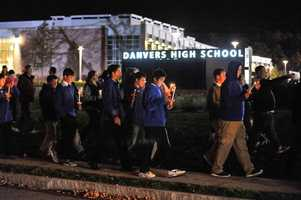 Mourners walk towards one of the high school fields during a candle light vigil held outside the Danvers High School for Danvers High School math teacher Colleen Ritzer who was murdered by one of her students, 14 year old Philip D. Chism.